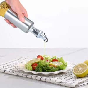 Made with stainless steel and glass. Glass bottom is good for identifying the type of oil and the remaining amount. Dust free nozzle with a convenient cap ensures flies and other small bugs do not enter. Drip-free spout design helps to control the volume of oil and spread it. Capacity: 200ML,300ML,500ML  Packge Included: 1x Oil Control Dispenser